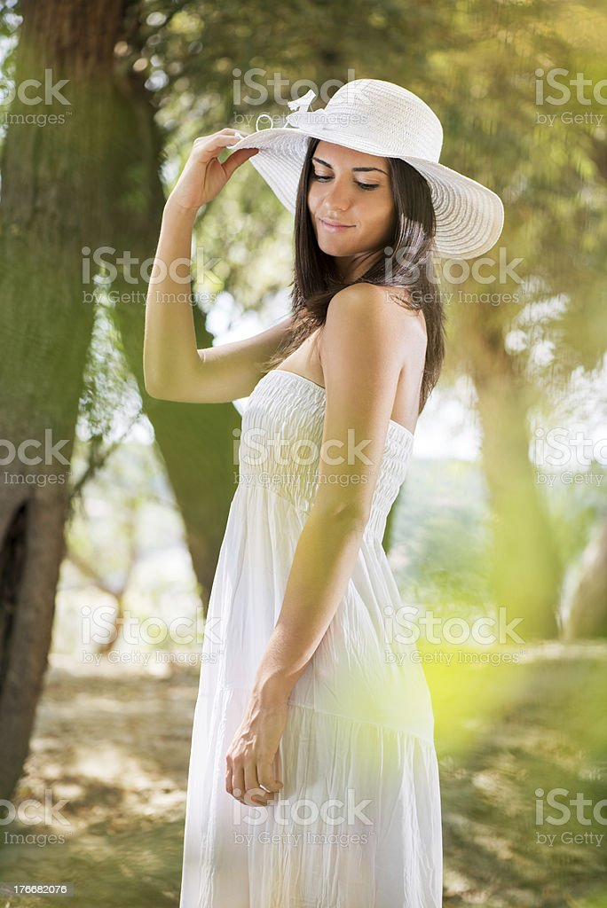 Beautiful woman with white sun hat royalty-free stock photo