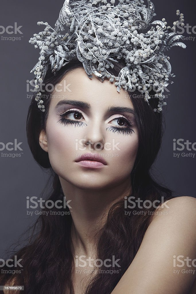 Beautiful woman with wreath of flowers royalty-free stock photo