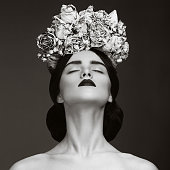 Beautiful woman with wreath of flowers.