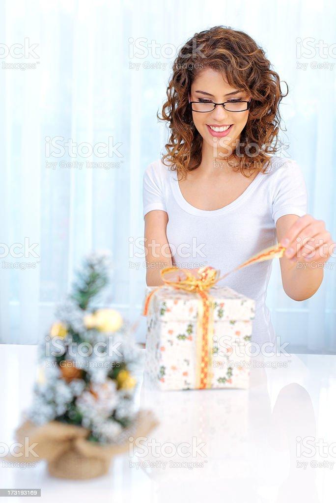 Beautiful woman with xmas gift royalty-free stock photo