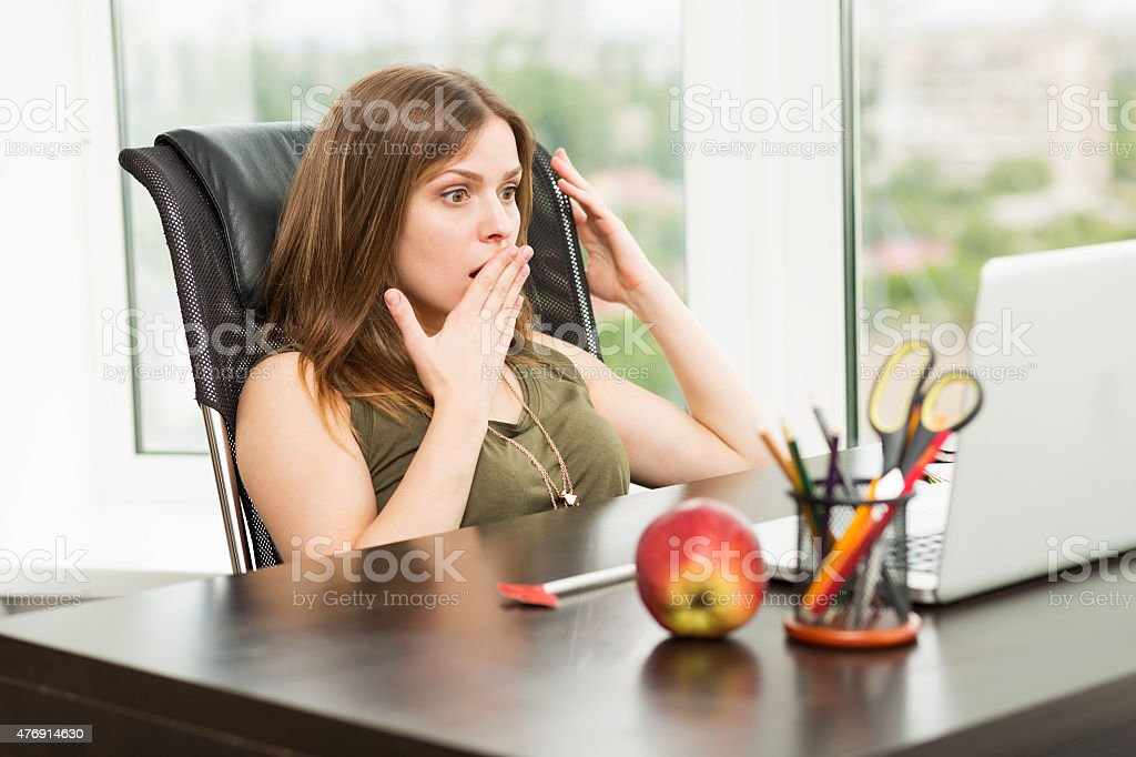 Beautiful woman working at the computer stock photo