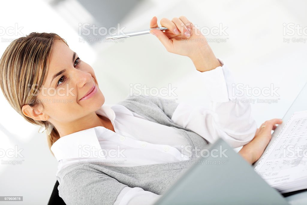 Beautiful woman working at the office. royalty-free stock photo