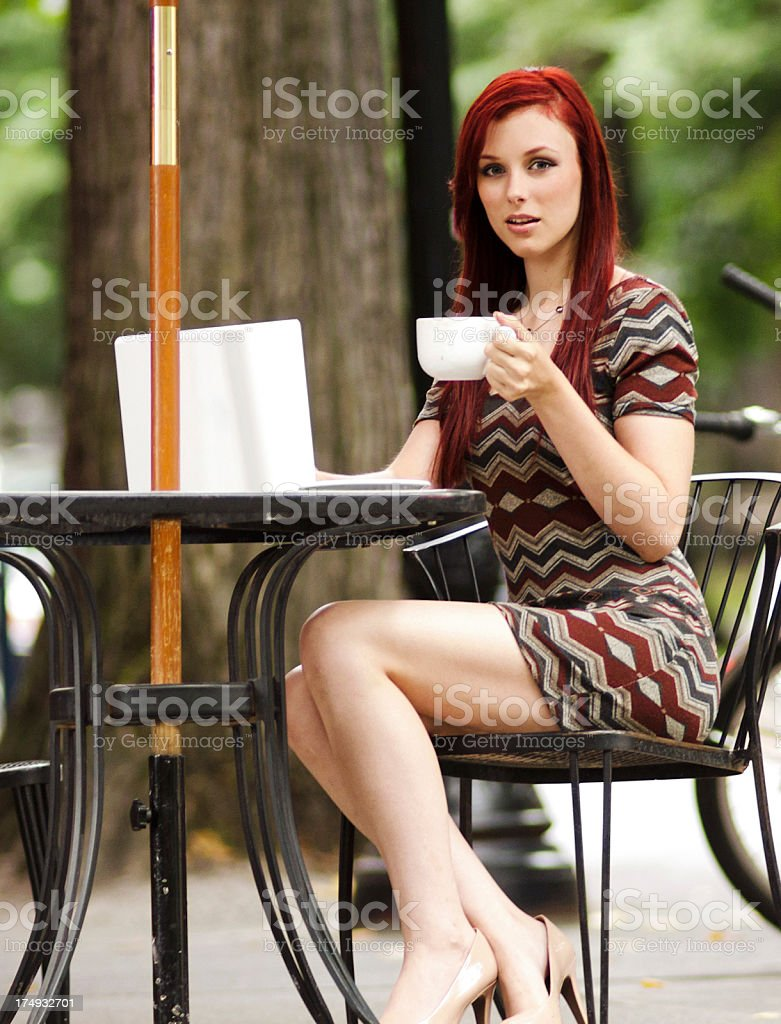 Beautiful woman working on her laptop royalty-free stock photo
