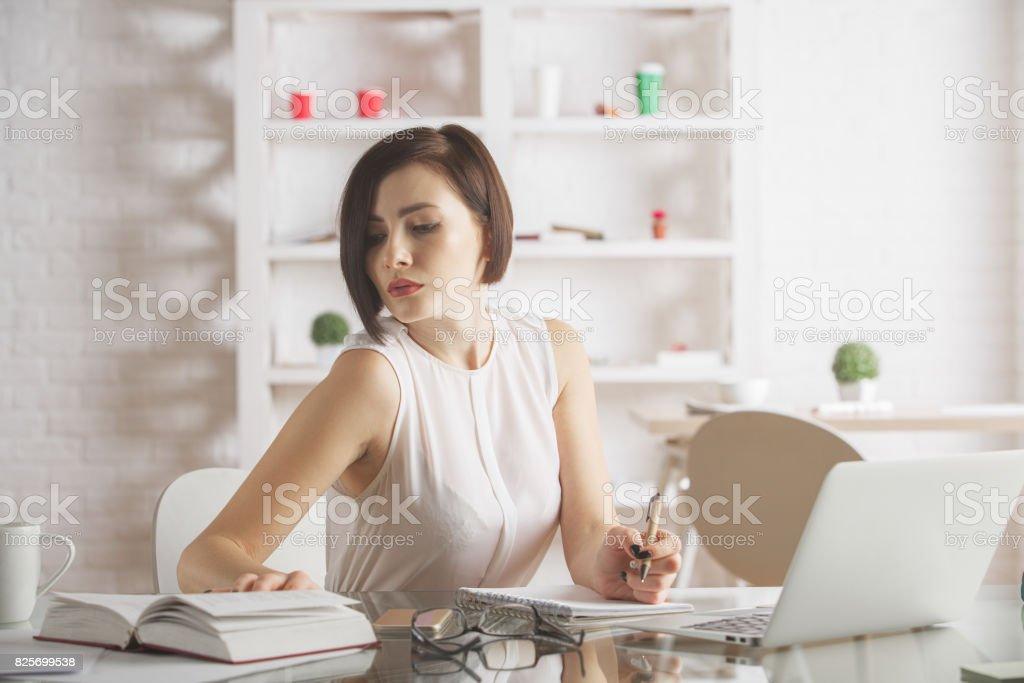 Beautiful woman working on project stock photo