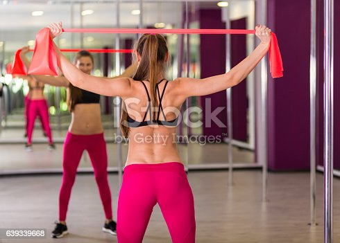 istock Beautiful woman working out at the fitness studio 639339668