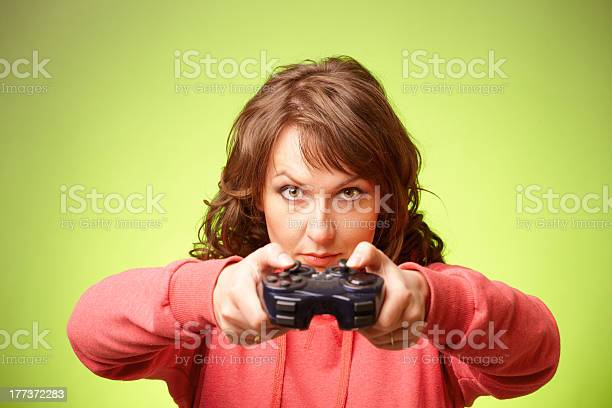 Beautiful Womanl With Gamepad Playing Vieogame Stock Photo - Download Image Now