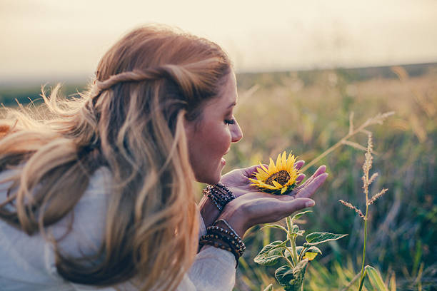 Beautiful womanl with sunflower outdoors Beautiful womanl with sunflower outdoors new age music stock pictures, royalty-free photos & images
