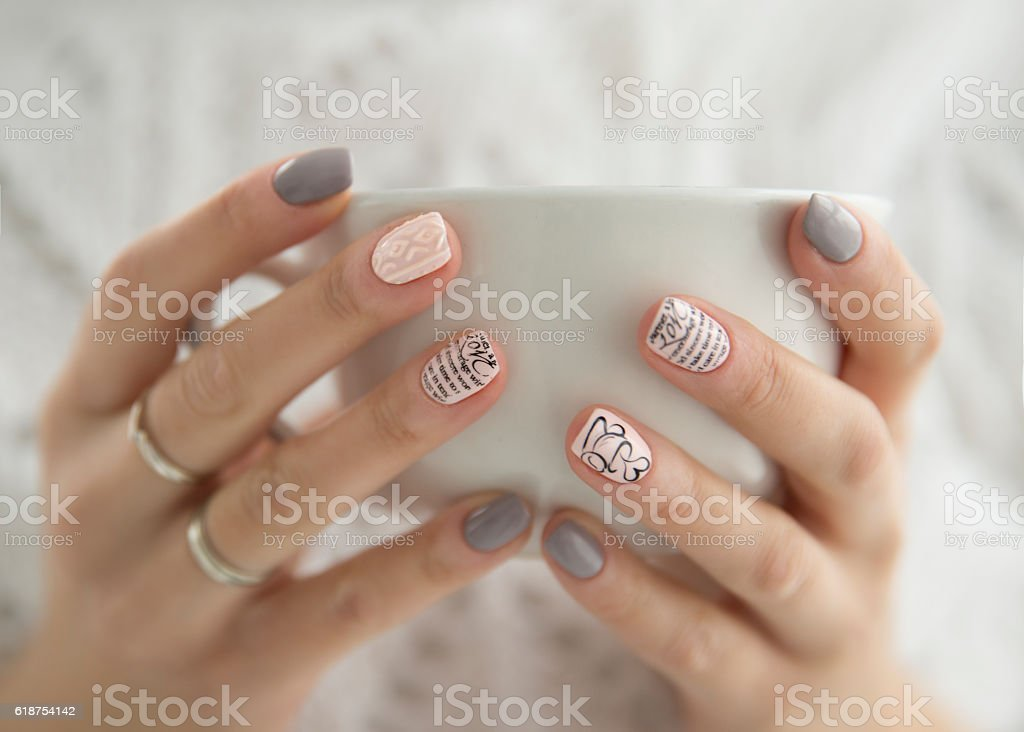 beautiful woman's hands holding a white cup stock photo