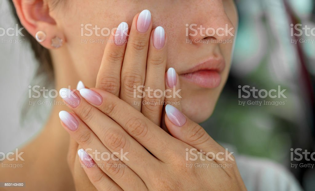 Beautiful woman's nails with beautiful french manicure ombre stock photo