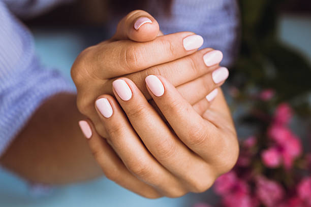 Beautiful woman's nails with beautiful pink manicure stock photo