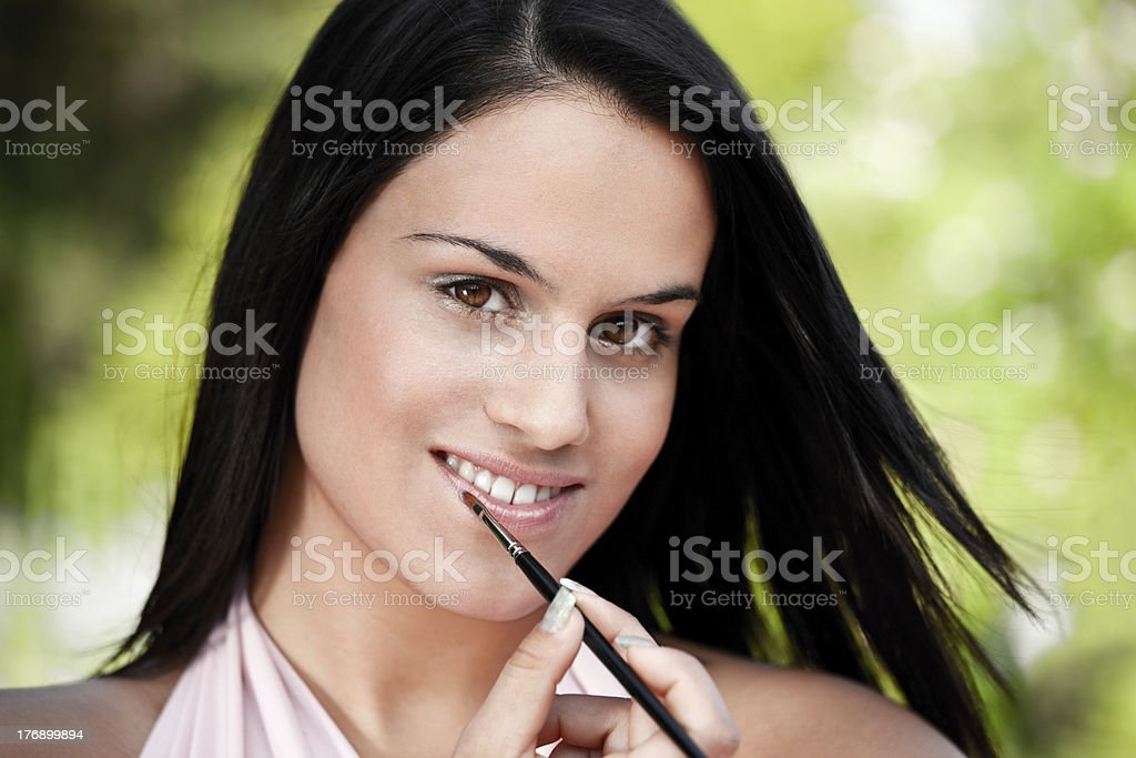 Beautiful women applying lipstick royalty-free stock photo