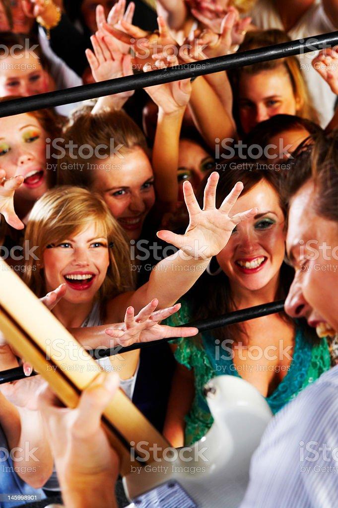 Beautiful women enjoying a guitar show at night club royalty-free stock photo