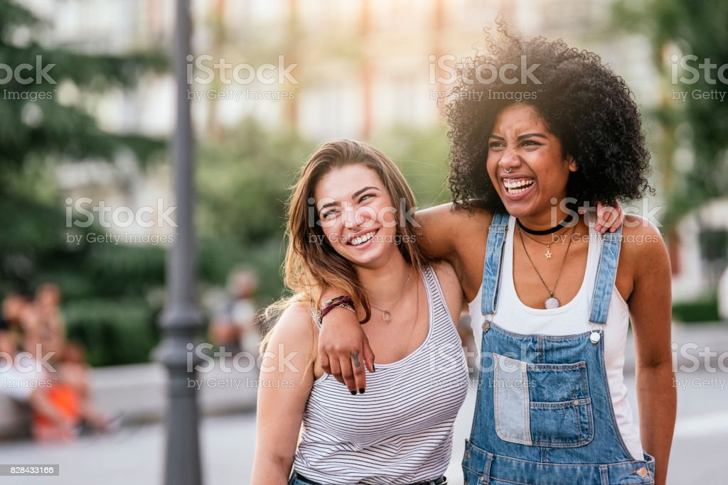 Beautiful women having fun in the street. stock photo