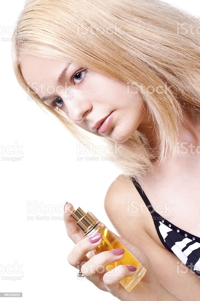 beautiful women in a dress with perfume royalty-free stock photo