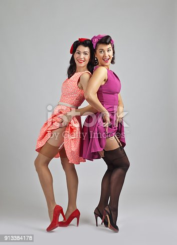 Beautiful women in pin up style with perfect hair and make up .Expressive facial expressions.
