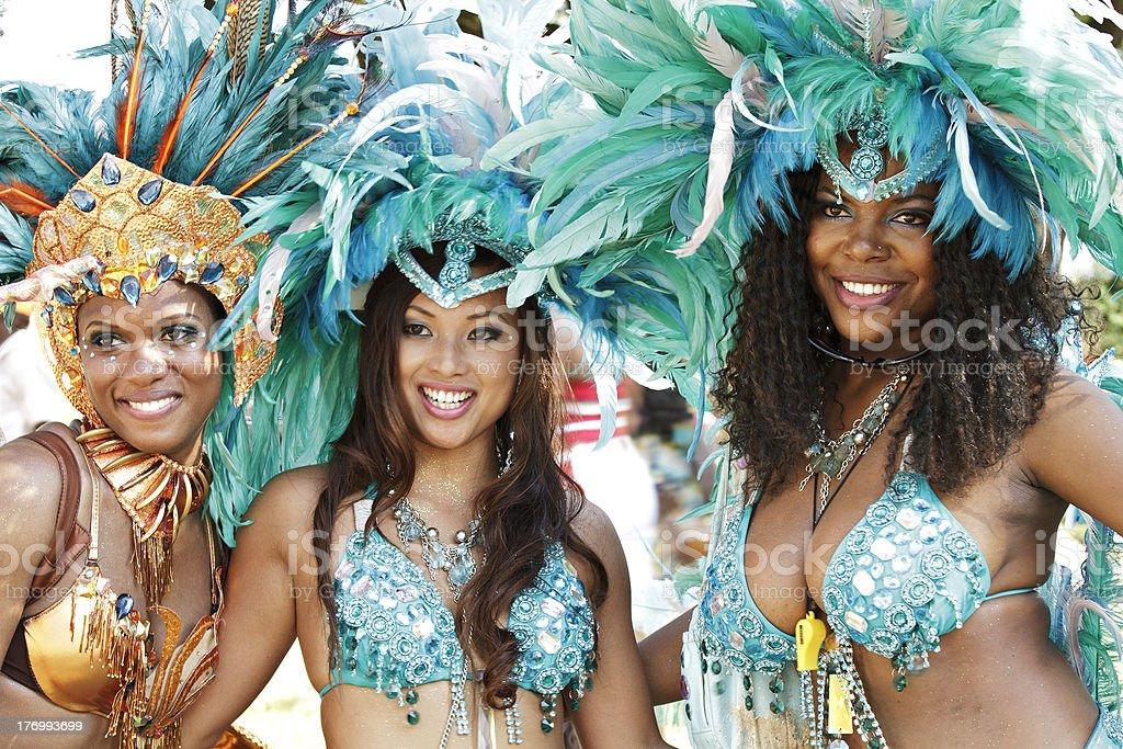 \'Young beautiful smiling black woman dressed in glittering feathered...