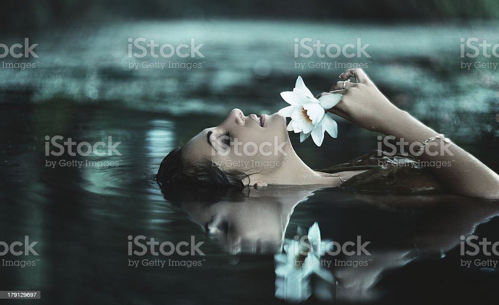 Beautiful women in water stock photo
