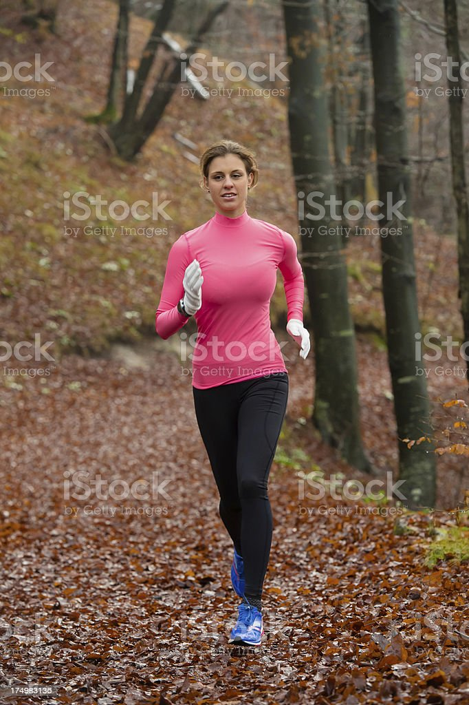 Beautiful women jogging on the forest path royalty-free stock photo