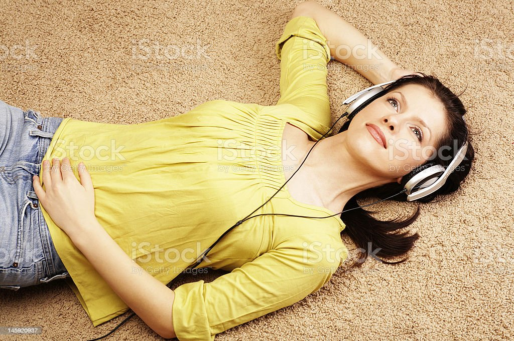Beautiful women listening music in headphones royalty-free stock photo