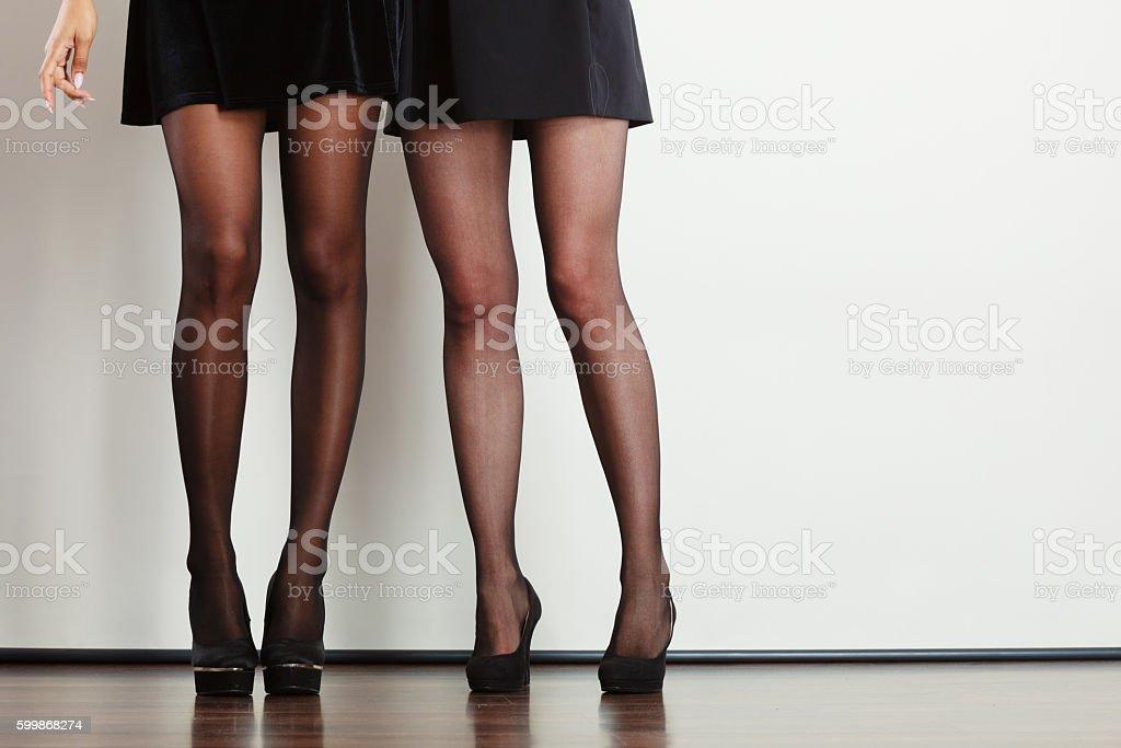 Beautiful women long legs. - Photo