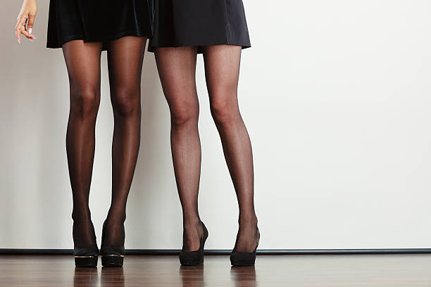 beautiful women long legs. - black women wearing pantyhose stock photos and pictures
