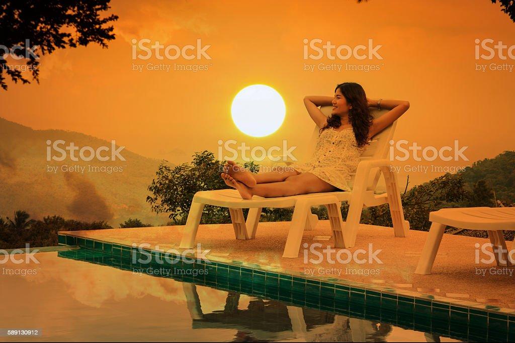 Beautiful women lying on chair stock photo