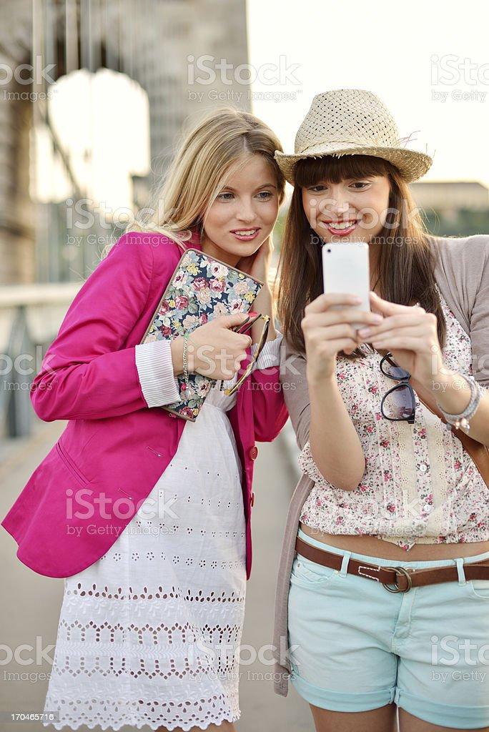 Beautiful women making selfie with smartphone royalty-free stock photo