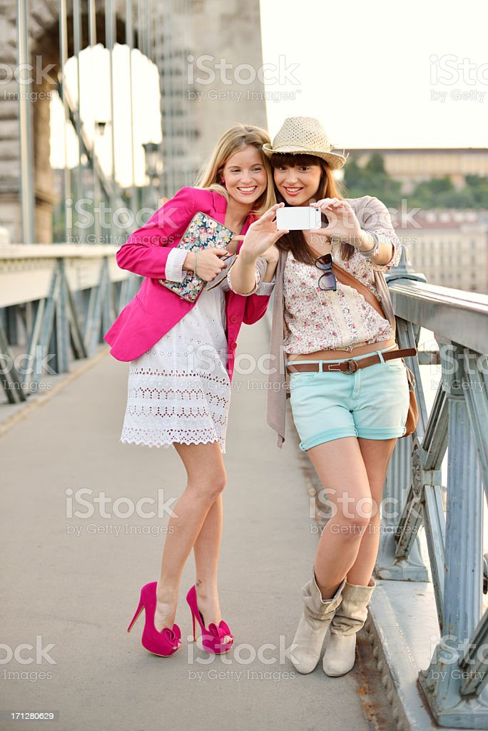 Beautiful women making selfie with smartphone royalty-free stock photo