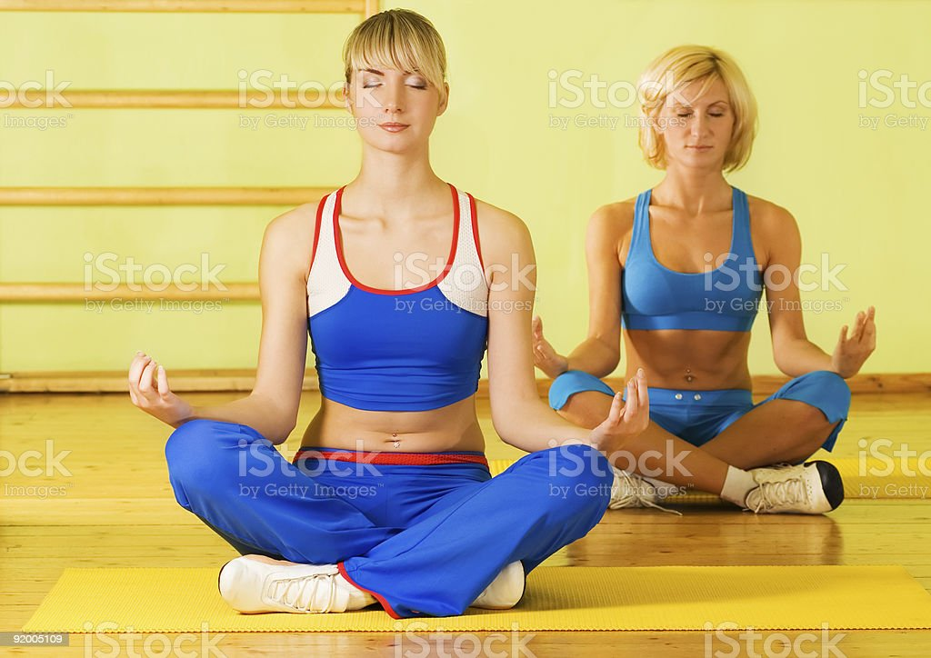 Beautiful women meditating royalty-free stock photo