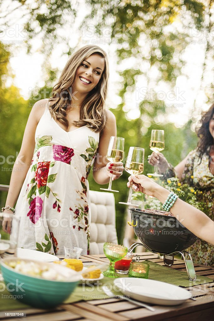Beautiful women outdoors on patio stock photo