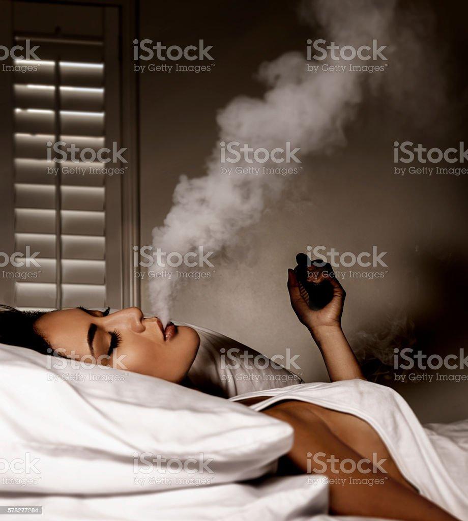 Beautiful women smoking an electronic cigarette stock photo