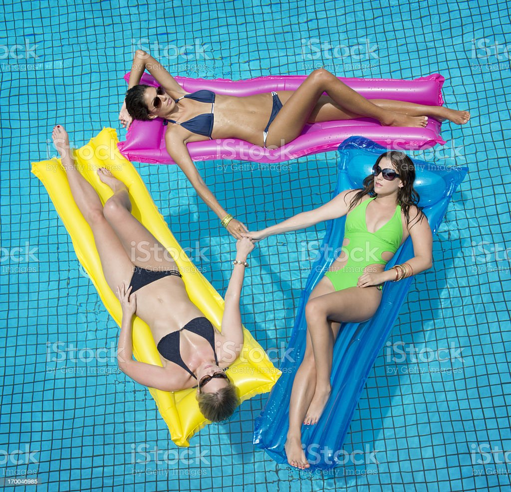 Beautiful Women sun bathing, Spa Pool royalty-free stock photo