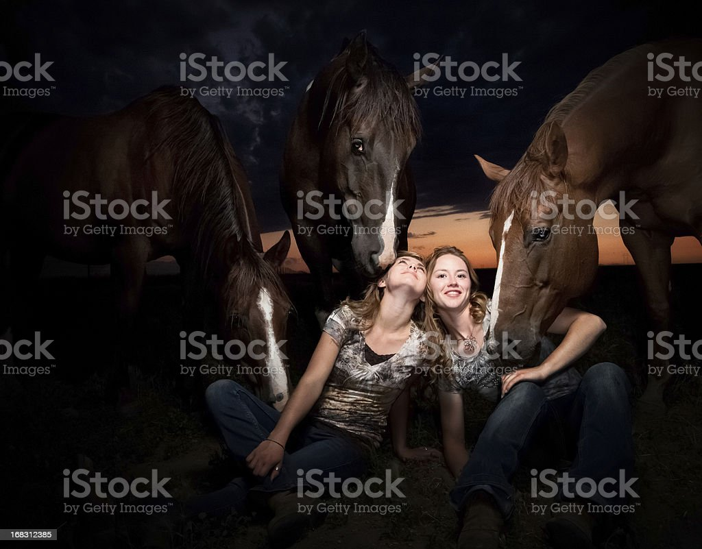 Beautiful Women Surrounded By Horses stock photo