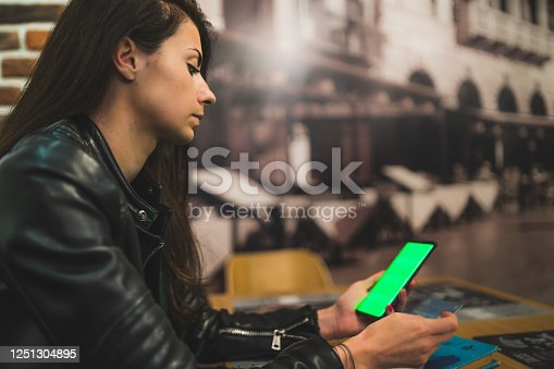 istock beautiful women using credit card and smartphone for online shoping in coffee shop 1251304895