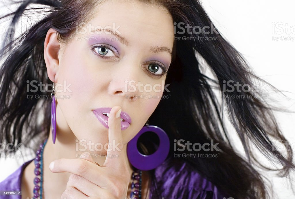 Beautiful women with finger on lips royalty-free stock photo