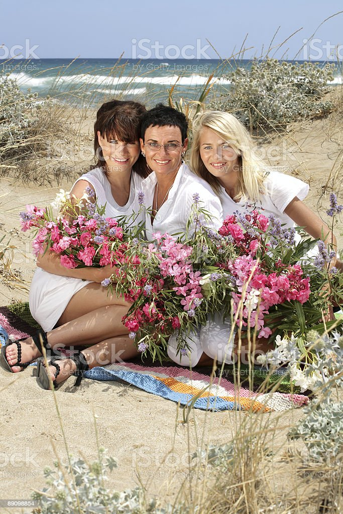 beautiful women with flowers royalty-free stock photo
