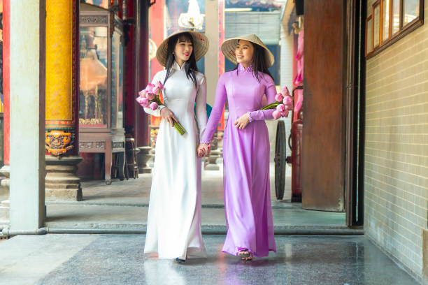 beautiful women with vietnam culture traditional dress, ao dai is famous traditional costume , ho chi minh vietnam. - ao dai stock photos and pictures