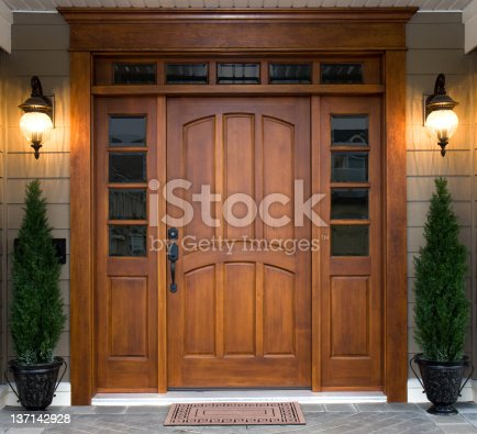 A beautiful wooden door graces the entrance to a west coast contemporary home.