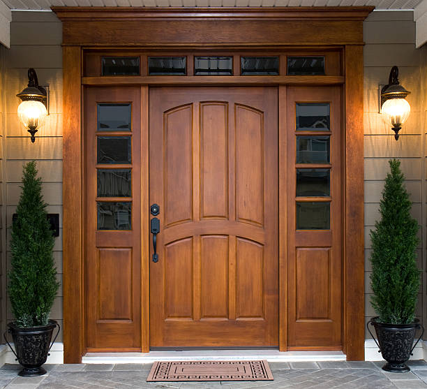 Beautiful Wooden Door A beautiful wooden door graces the entrance to a west coast contemporary home. front door stock pictures, royalty-free photos & images