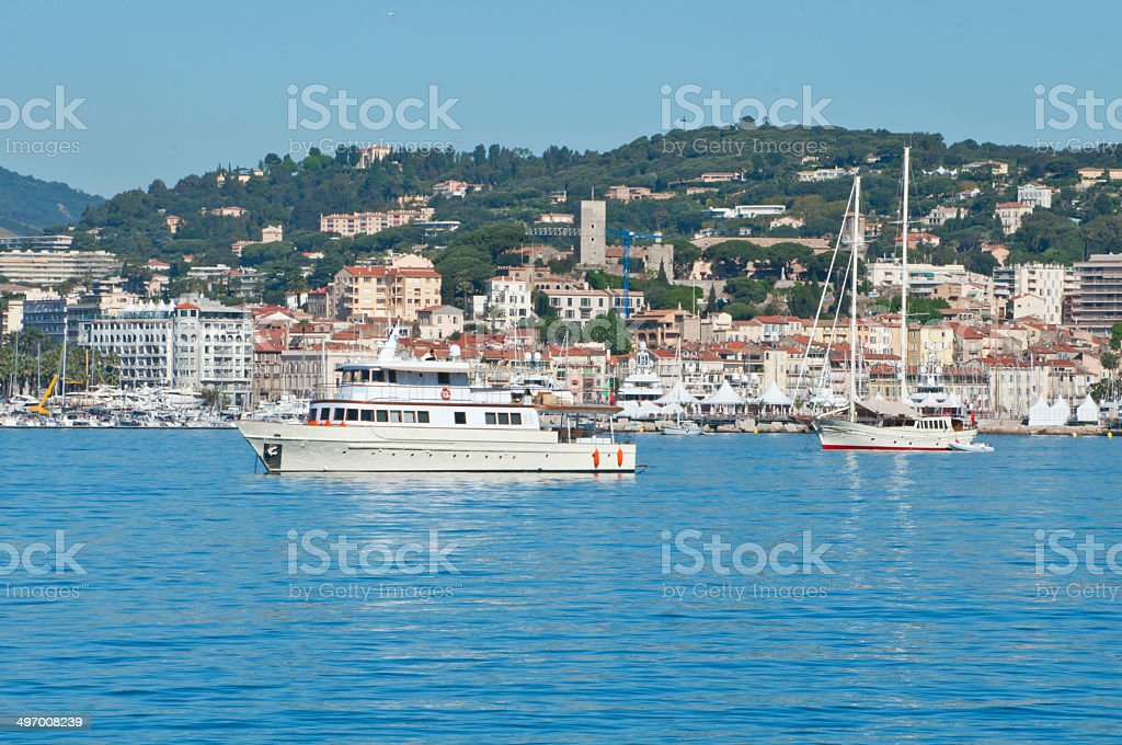 Beautiful yachts on a sparkling blue sea in Cannes, France stock photo
