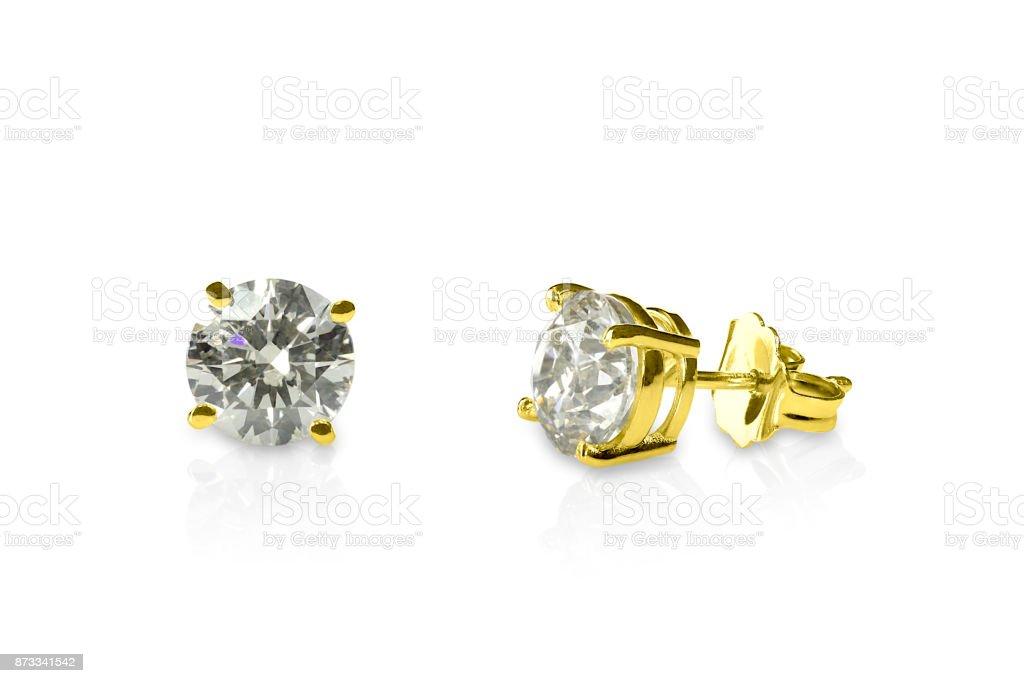 Beautiful yellow gold diamond stud earrings round brilliant. Diamond earrings. stock photo