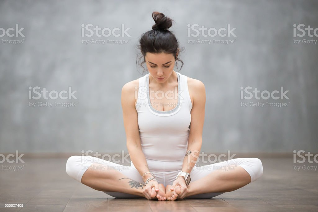 Beautiful Yoga: Bound angle pose stock photo