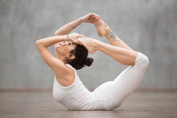 beautiful yoga: bow pose - gymnastik tattoo stock-fotos und bilder