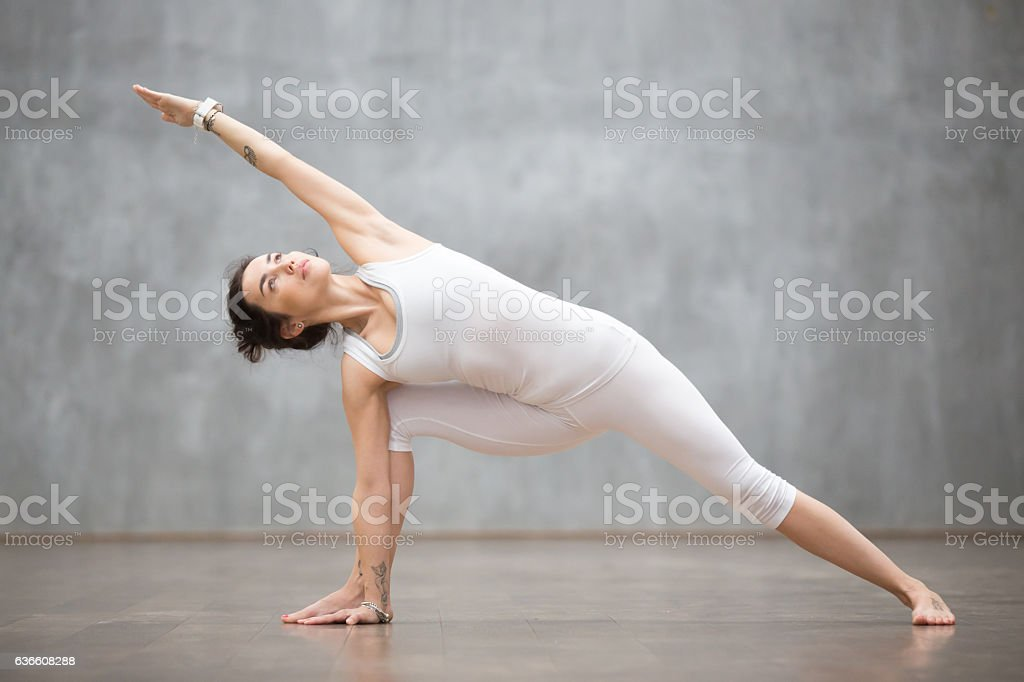 Beautiful Yoga: extended side angle pose stock photo
