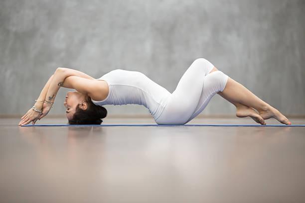 beautiful yoga: fish pose - gymnastik tattoo stock-fotos und bilder