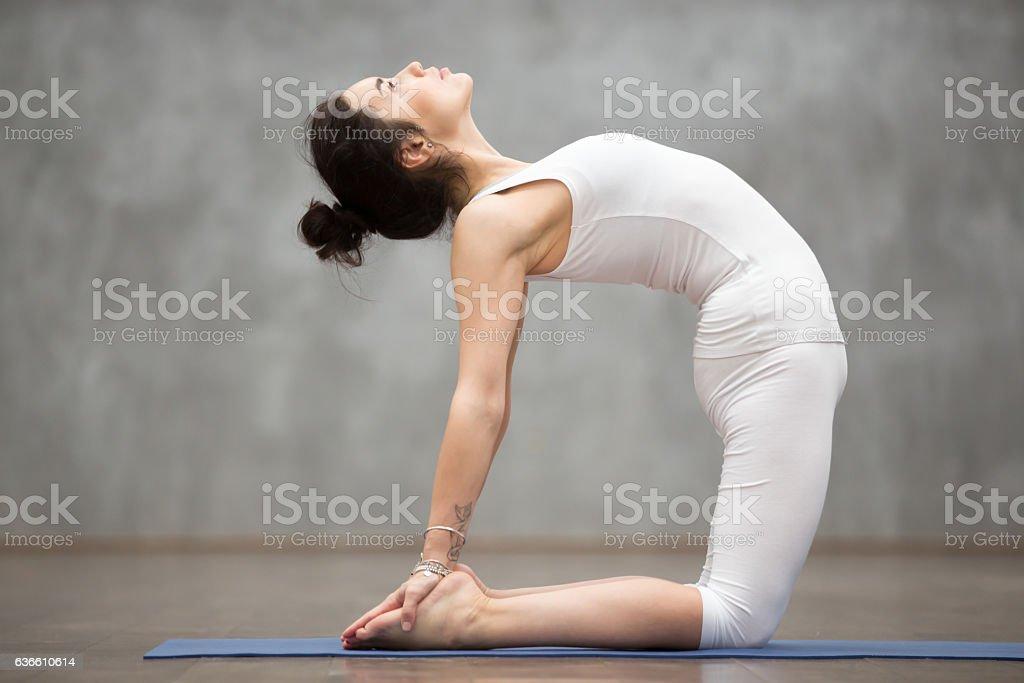 Beautiful Yoga: ushtrasana pose stock photo