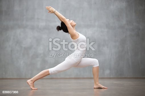 istock Beautiful Yoga: Warrior one pose 636607966