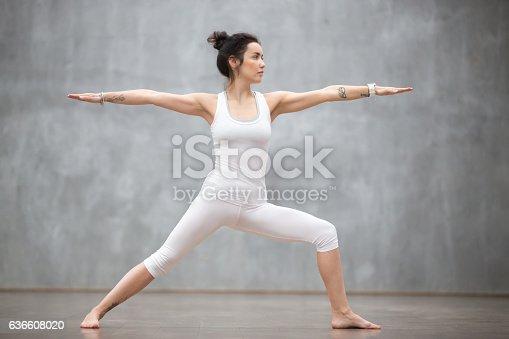 istock Beautiful Yoga: Warrior two pose 636608020