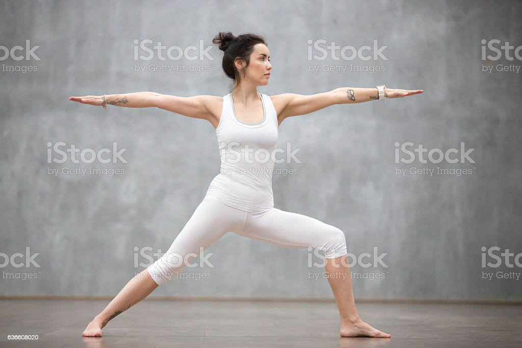 Beautiful Yoga: Warrior two pose stock photo