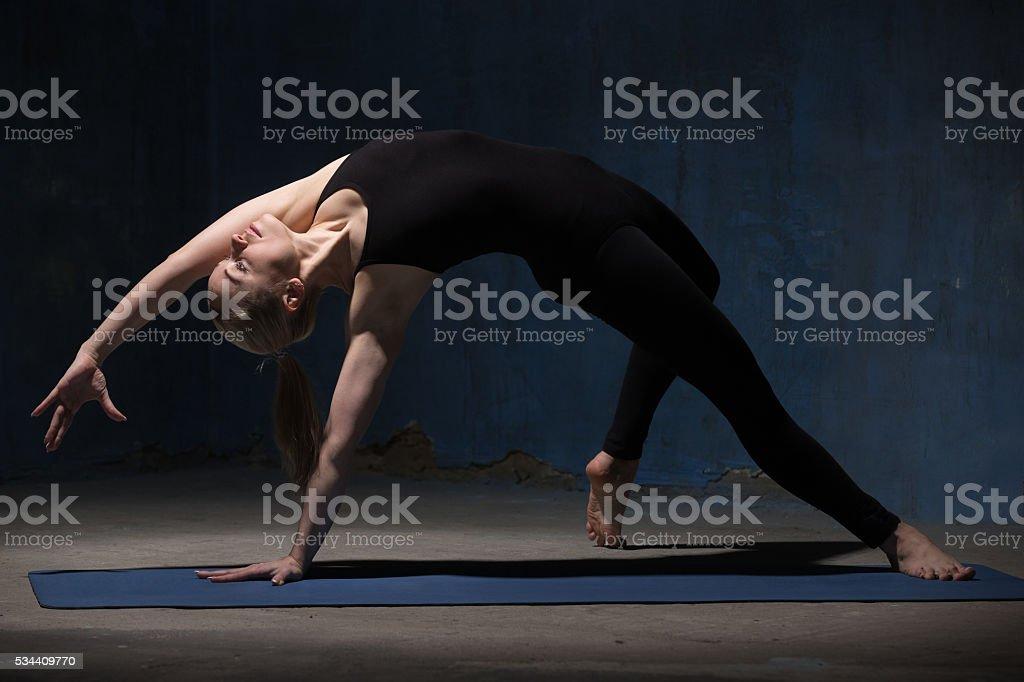 Beautiful Yoga Woman Doing Wild Thing yoga pose stock photo